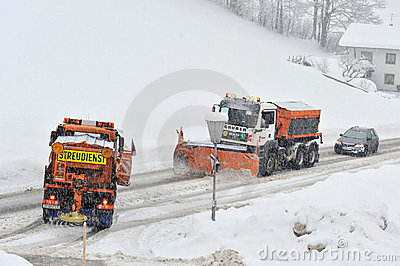 Snow remover trucks at work Editorial Image
