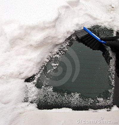 Snow removing from car