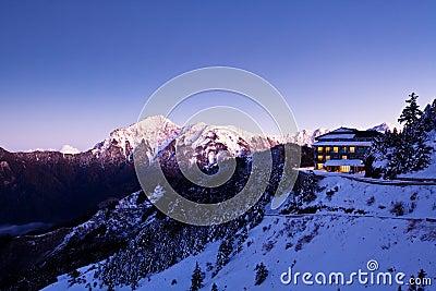 Snow scene of a cabin
