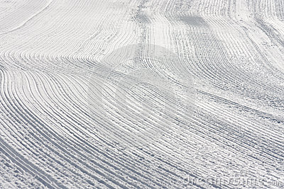 Snow tracks on slope made by Ratrack