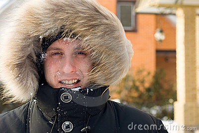After snowball fight - man in warm jacket