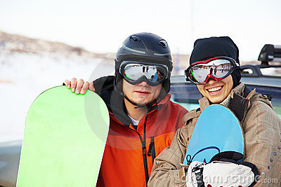 Snowboard couple on ski resort