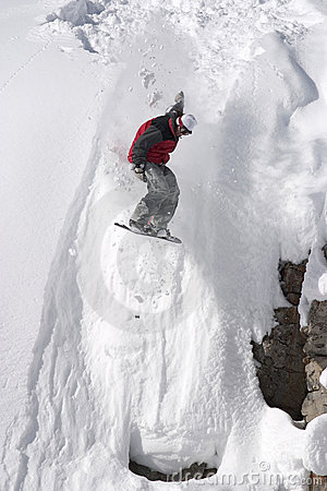 Free Snowboard Jump From A Cliff In The Powder Stock Images - 156034