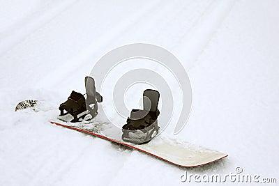 Snowboard on Ski Track