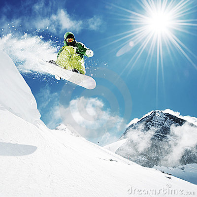 Free Snowboarder At Jump Inhigh Mountains Stock Photography - 20531682