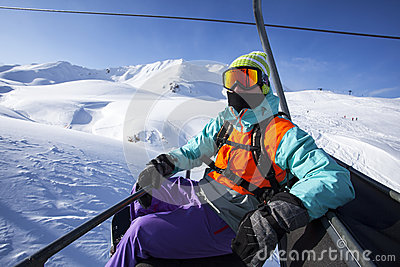 Snowboarder On The Chairlift Royalty Free Stock Photo Image 34139585