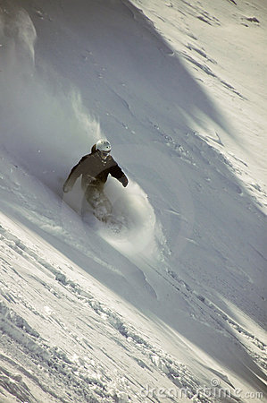 Snowboarder in deep powder