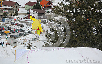 Snowboarder flying over Arena Platos, Paltinis Editorial Stock Photo