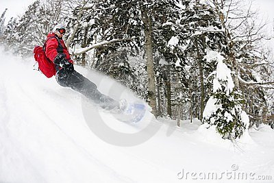 Snowboarder on fresh deep snow