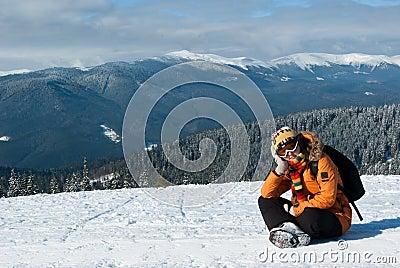 Snowboarder girl resting