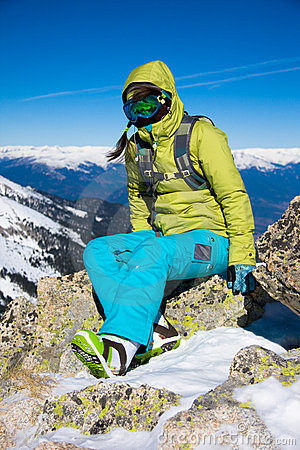 Snowboarder girl sitting