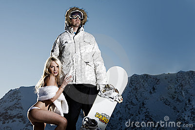 Snowboarder with groupie girl