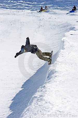 Snowboarder on half pipe of Pradollano ski resort in Spain