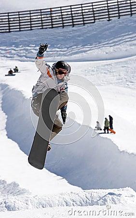 Snowboarder on half pipe of Pradollano ski resort in Spain
