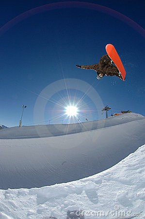 Snowboarder jumping high