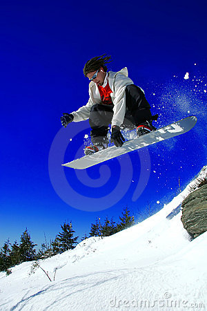 Free Snowboarder Jumping Over The Rock Stock Images - 7298984