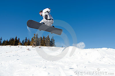 Snowboarder jumping from snow kicker