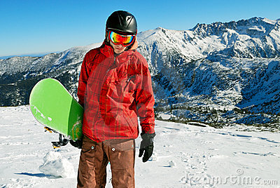 Snowboarder with mountains on background