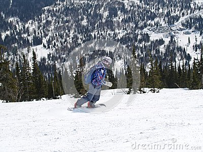 Snowboarder in the mountains Shoria