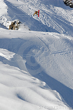 Snowboarder performing a freestyle jump