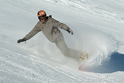 Snowboarder in splashes of snow