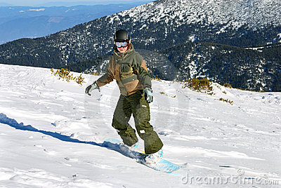 Snowboarder woman under sun