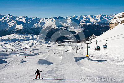 Snowboarders on a snow park