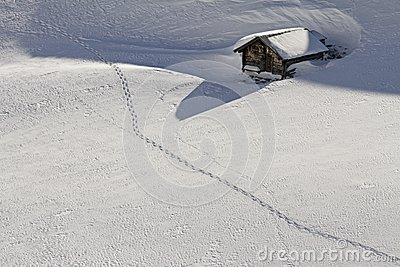 Snowbound hut with snow shoe tracks
