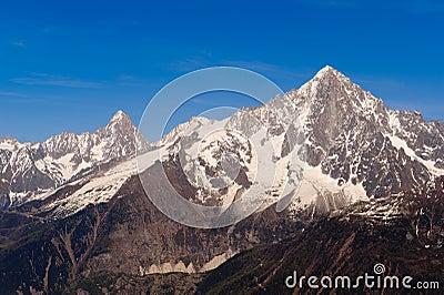 Snowbound mountain peaks. French Alps