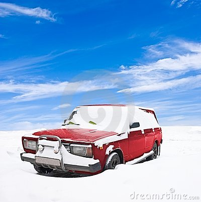 Snowbound red car