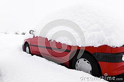 Snowbound red car