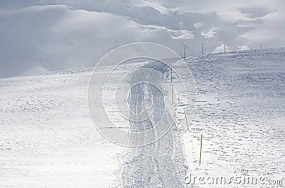 Snowcat tracks on hillside