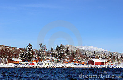 Snowcovered Cabins at the Fjord
