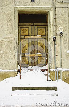 Snowed in decayed front door
