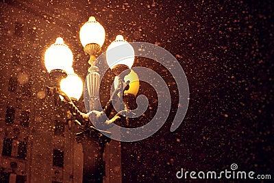 Snowfall and lantern