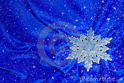 Snowflake on a blue silk with sparkles