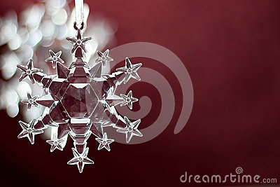 Snowflake ornament on red background