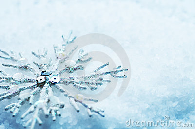 Snowflake in snow. Christmas
