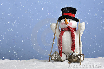 Snowing on cute snowman on skis