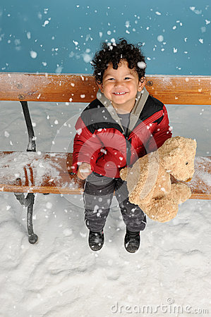 Snowing on a little boy