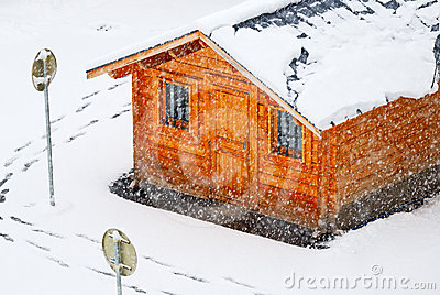 Snowing and wood house