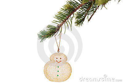 Snowman cookie hanging on christmas tree branch