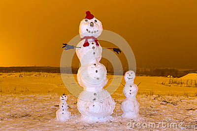 Snowman family in winter scenery