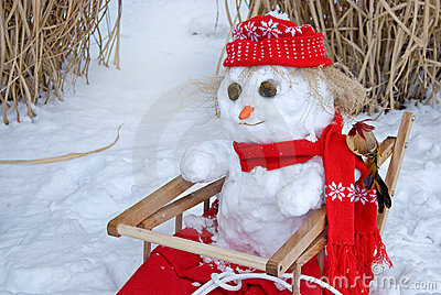 Snowman in sled