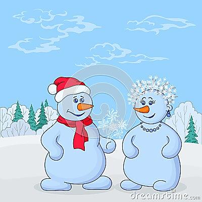 Snowmans in winter forest