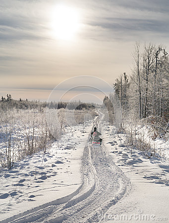 Free Snowmobile Heading Into Sunlight. Stock Photography - 36925422