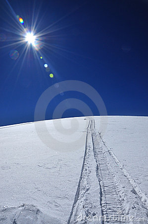Free Snowmobile Tracks In The Snow Stock Photography - 18798512