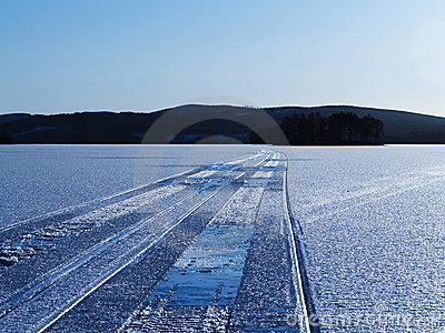 Snowmobile tracks on lake