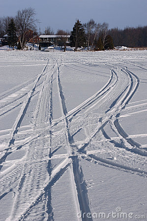 Snowmobile Tracks in Snow During Winter