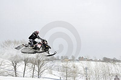 Snowmobile unidentified rider airborne Editorial Photography